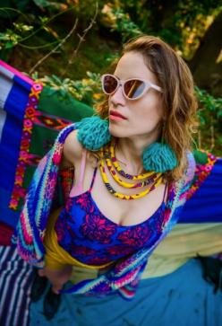 "Alyssa in Kasa Kava ""aqua"" pom-pom earrings and PatternNation yellow necklace."