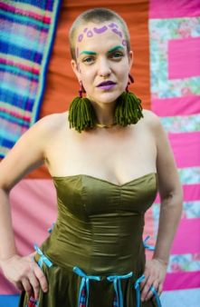 "Ingrid in Kasa Kava ""moss"" pom-pom earrings."