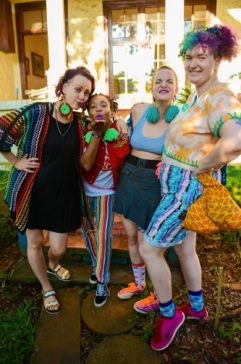 "From left to right: Cath (""red rim"" eye-rings, Kava (""electric feel"" pom-pom), Ingrid (""aqua"" pom-pom), and Cyd Eva (photographer and founder of PatternNation)."
